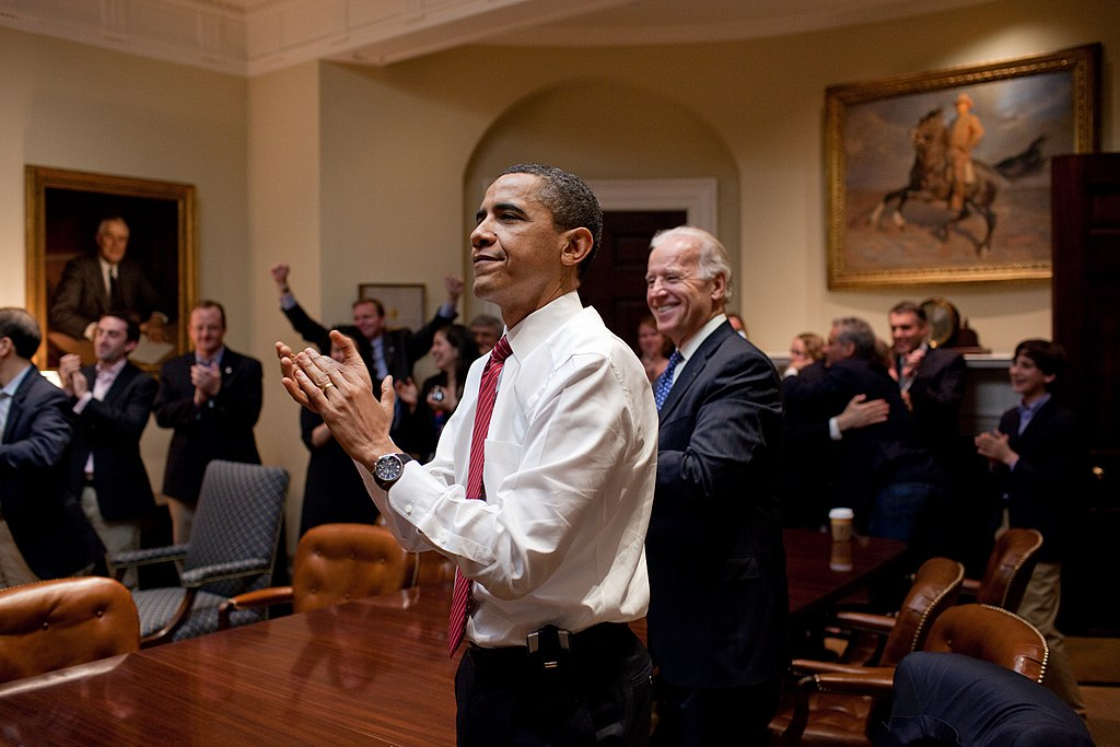 President Obama Appaulds after the Affordable Care Act is passed by Congress
