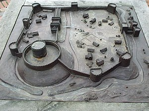 Falkes de Breauté - Model of how Bedford Castle may have looked.  The River Great Ouse is on the left. The model predates archaeological excavations in 2007/8, which revealed the outlines of some of the main structures in the inner bailey (on the left here), including the great hall. The position of the main gate is unclear.