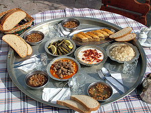 "Turkish cuisine - Turkish dishes on a ""sini"", or large tray, that was formerly used in the rural areas as a traditional alternative to a table."