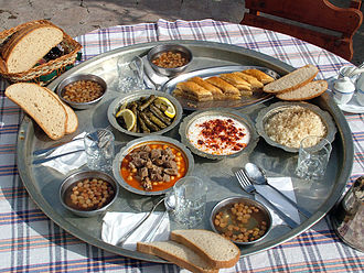 "Turkish cuisine - A variety of Turkish dishes on a ""sini"", or large tray, that was formerly used in the rural areas as a traditional alternative to a table."