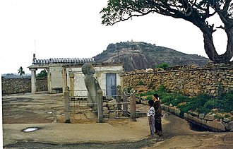 Chandragiri hill - A rare statue of Bharata, brother of Bahubali whose statue is seen behind on the Vindhyagiri hill