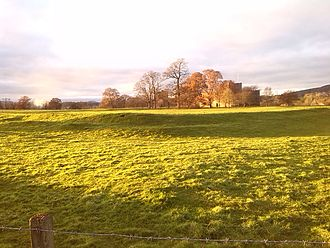 Brocavum - Banks of Brocavum Roman fort in foreground, Brougham Castle behind, and 18th-century Carleton Hall to the left