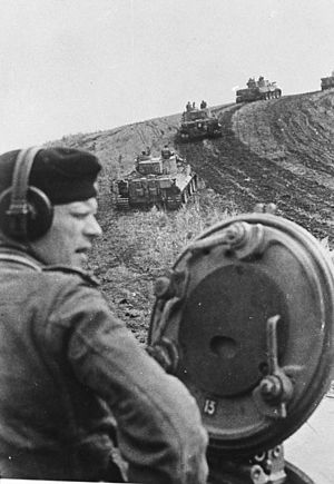Belgorod-Kharkov Offensive Operation - Tiger I tanks advance up a hillside near Belgorod, August 1943