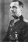 Black-and-white portrait of a man in semi profile wearing a military uniform with an Iron Cross displayed at his neck.