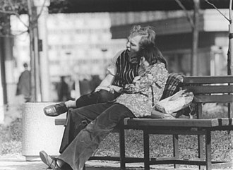 Boyfriend - A woman with her boyfriend at Alexanderplatz in March 1975.