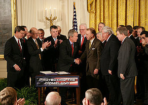 History of the Patriot Act - George W. Bush shakes hands with U.S. Senator Arlen Specter after signing H.R. 3199, the USA PATRIOT Improvement and Reauthorization Act of 2005