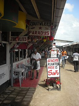 Butcher market in Paramaribo with signs written in Dutch Butcher Paramaribo market.jpg