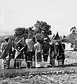 COLLECTIE TROPENMUSEUM Studenten van de Akademi Seni Karawitan Indonesia in traditionele kledij op de rug gezien TMnr 20000324.jpg
