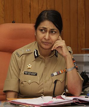 Police commissioner - Police Commissioner of Pune, India, in 2010. Her insignia indicates her rank of DGP or Additional DGP.