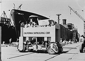 California Shipbuilding Corporation - Motorized hoisting truck used in moving scaffolding timbers around the shipyard, 1942.