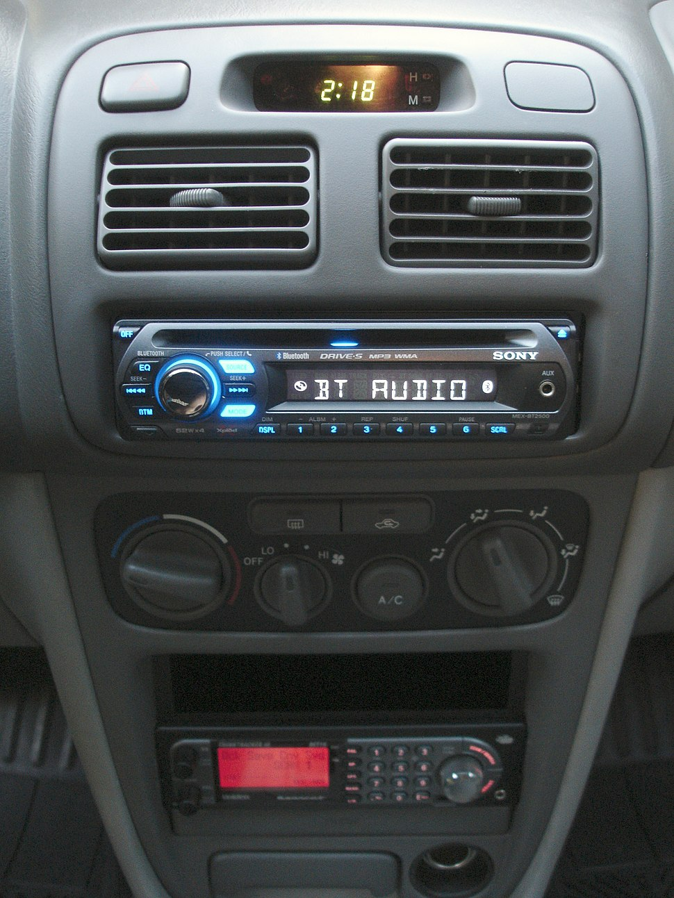 Car dashboard with MEX-BT2500 head unit and BCT-15 radio scanner installed and illuminated.jpeg