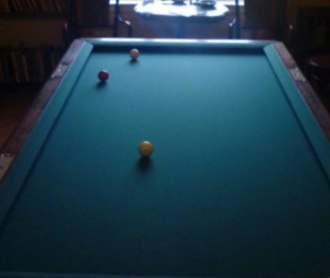 Carom billiards - A carom billiard table and billiard balls