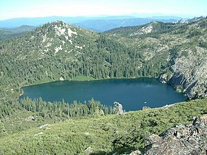 Castle Lake (California) - Castle Lake with the headwall at the right, and the terminal moraine at the left.