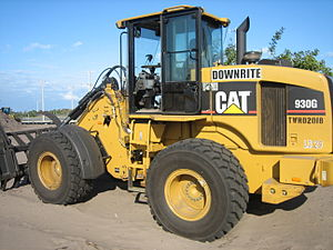 Caterpillar 930G - A Caterpillar 930G fitted with a loader rake on a residential construction site in South Florida.