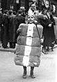 Child in King Cotton costume during a New Orleans Mardi Gras parade in 1937.jpg