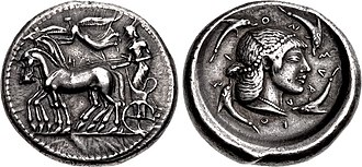 Gelo - Silver coin of Gelon, struck at the Syracuse mint, dated 480-478 BC. Obv: Charioteer and horses, goddess Nike flying above. Rev: Head of Arethusa, encircled by four dolphins.