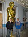 Couple with Paul Bunyan Statue (5079680749).jpg