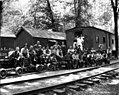 Crew posed on railroad cars at camp, Brookings Timber and Lumber Company, Brookings, ca 1919 (KINSEY 2152).jpeg
