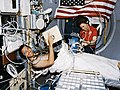 Crewmembers in the spacelab with the Lower Body Negative Pressure Study.jpg