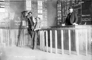 Spencer Penrose - Spencer Penrose (middle) stands in a mining exchange in Cripple Creek, Colorado, 1895.