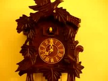 A Cuckoo clock striking the 8th hour with mechanical automaton and the sound of a Cuckoo's call to mark the hours.