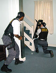 Two DEA agents in a shoot house exercise.