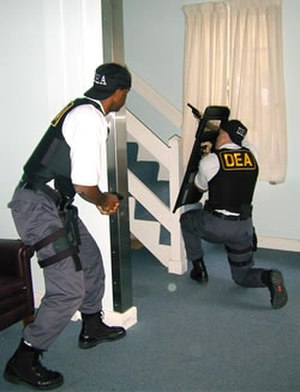 Drug Enforcement Administration - Two DEA agents in a shoot house exercise.