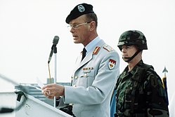 DF-ST-92-09294 Brig. GEN. Hartmut Bagger, a German officer, addresses the crowd of civilians and military personnel of the U.S. Army's 1ST Infantry Division.jpeg
