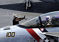 Defense.gov News Photo 120425-N-WD757-356 - A plane captain signals to the pilot of an F A-18F Super Hornet on the flight deck of the aircraft carrier USS Abraham Lincoln CVN 72 as the ship.jpg