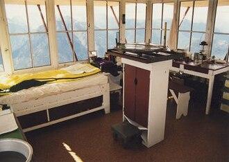 Desolation Peak (Washington) - Interior of Desolation Peak Lookout, with bed and firefinder.