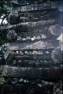 Image of columnar basalt pieces, 3 to 6-sided, stacked in alternating directions to build a thick wall at Nan Madol, Pohnpei, Micronesia