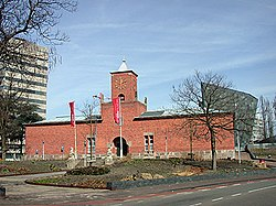 Red brick building with a central tower