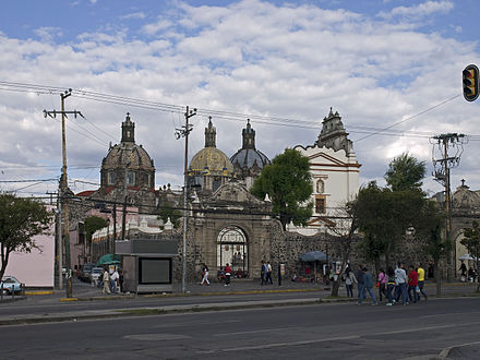 Some neighborhoods, such as San Angel, retain a distinct urban design from their time as independent towns. El Carmen Church San Angel.jpg