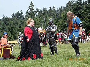 Elspeth serving bacon to the troops at Honey War 2012.jpg