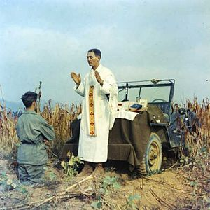 Emil Kapaun - Father Emil Kapaun celebrating Mass using the hood of a jeep as his altar, October 7, 1950