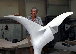 Richard Erdman (artist) - Richard Erdman with his marble sculpture, Volante.