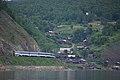 Excursion train of Circum-Baikal railway- ED9MK-0029 EMU under TEM2-6550 (31462550203).jpg