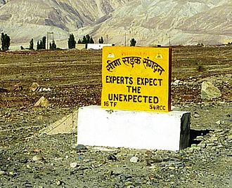 "Expert - ""Experts Expect the Unexpected."" Roadsign in Nubra Valley, northern Ladakh, India."