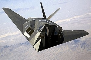 Stealth aircraft - An F-117 Nighthawk stealth strike aircraft flying over Nevada in August 2002.