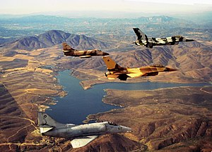 United States Navy Strike Fighter Tactics Instructor program - TOPGUN F-16 and A-4 aircraft in formation over Lower Otay Reservoir