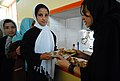 Fawzia passes a student a plate of food during lunch. (4510646203).jpg