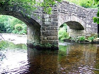 Fingle Bridge - A closer view of the ashlar stone piers from upstream