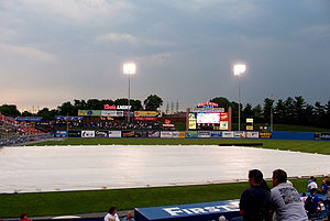 Rainout (sports) - When the weather threatens to rain out a baseball game, the groundskeepers cover the infield with a tarp to protect it from damage.