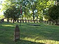 Flagpole in the middle of graves in Heroes' Cemetery, Eger, 2016 Hungary.jpg