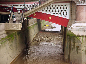 River Fleet - The mouth of the River Fleet in 2002, appearing as a drainage outlet (obscured in shadow) in the embankment wall beneath Blackfriars Bridge