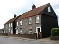 Flint and brick cottages - geograph.org.uk - 853011.jpg