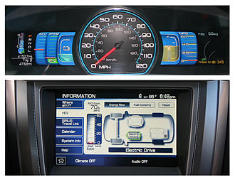 Ford Fusion (Americas) - The Fusion Hybrid has digital panels to track eco driving (top), and current hybrid drive propulsion (bottom).