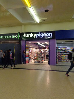 A WHSmith owned Funky Pigeon shop at Leeds railway station Funky Pigeon.com shop, Leeds railway station (19th July 2014).JPG