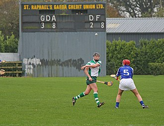 Scoring in Gaelic games - Scoreboard at a hurling game. The Garda Síochana team lead the Defence Forces by 3-8 to 2-8 (i.e., 17 to 14).