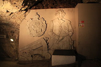 Great Siege Tunnels - Concrete depiction of George Augustus Eliott, a Koehler Depressing Carriage and the crest of the Royal Engineers at the entrance to the tunnels.